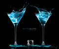 Two Cocktail Glasses with Blue Vodka. Style and Celebration Conc - PhotoDune Item for Sale