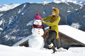 Girl decorating a snowman - PhotoDune Item for Sale