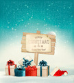 Winter christmas with a sign, gift boxes and a santa hat background. - PhotoDune Item for Sale