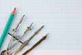 Old drawing tools on graph paper - PhotoDune Item for Sale