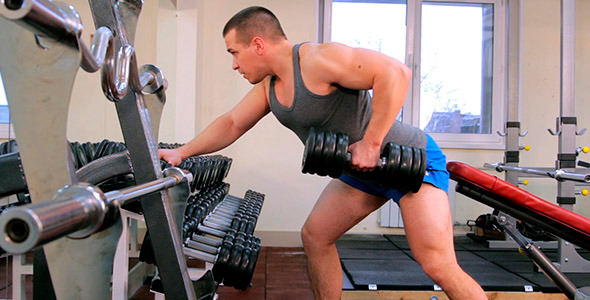 The Man Pulls The Dumbbell 1