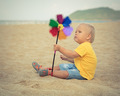 Baby with toy windmill - PhotoDune Item for Sale