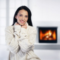 Woman relaxing by the fireplace - PhotoDune Item for Sale