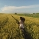Flying over Girl Running through Wheat Field 5 - VideoHive Item for Sale