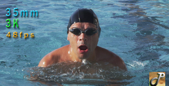 Man Swims Breaststroke Style In A Pool Outdoors