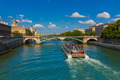 Tourist boat on river Seine in Paris, France - PhotoDune Item for Sale