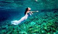 Beautiful woman relaxing in the water - PhotoDune Item for Sale