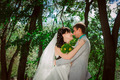 Married Couple in forest embracing