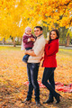 Picture of lovely family in autumn park