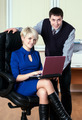 Young attractive business people work with laptop - PhotoDune Item for Sale