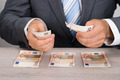 Businessman Counting Money - PhotoDune Item for Sale