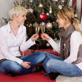 two girls drinking a glass of champagne - PhotoDune Item for Sale