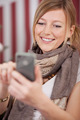 Smiling attractive blond woman with a mobile - PhotoDune Item for Sale