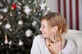 elegant woman beside the christmas tree - PhotoDune Item for Sale