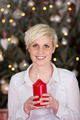 Blond woman holding a red burning candle - PhotoDune Item for Sale
