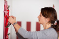 Woman Fixing Christmas Decoration on the Wall - PhotoDune Item for Sale