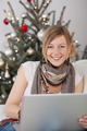 Woman with Laptop on Christmas Tree Background - PhotoDune Item for Sale