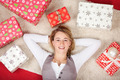 Woman Relaxing on the Floor with Christmas Gifts - PhotoDune Item for Sale