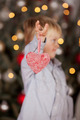 Little boy holding a heart Christmas decoration - PhotoDune Item for Sale