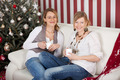 women relaxing on the sofa on christmas - PhotoDune Item for Sale