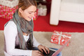 Blond Woman with Scarf Using Laptop Near Gift Box - PhotoDune Item for Sale