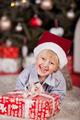 Playful little boy in a Santa Hat - PhotoDune Item for Sale