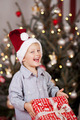 Adorable little boy holding his Christmas gift - PhotoDune Item for Sale
