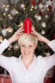 funny woman holding a candle on her head - PhotoDune Item for Sale