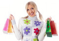 Young smiling attractive woman with shopping bags over white background - PhotoDune Item for Sale