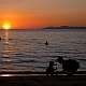 Mother with Child near Sea at Sunset - VideoHive Item for Sale