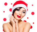 Christmas Woman. Beauty Model Girl in Santa Hat over White - PhotoDune Item for Sale
