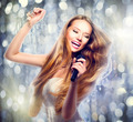 Beauty model girl with a microphone singing and dancing - PhotoDune Item for Sale