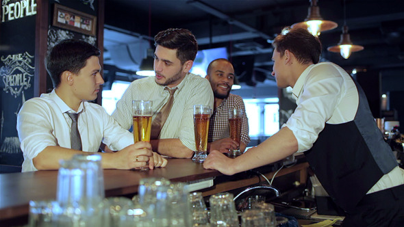 Activities Of Real men in a Bar With Beer