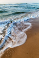 Sea waves in the white foam on the sandy beach. Dawn. - PhotoDune Item for Sale