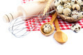 Quail eggs, flour and cooking utensils on canvas on white backgr - PhotoDune Item for Sale