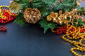 Christmas decoration, fir branch, pine cones, tinsel on a black - PhotoDune Item for Sale