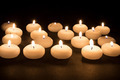 Several white candles at a black background - PhotoDune Item for Sale