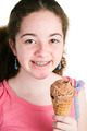 Girl with Braces Eating Ice Cream - PhotoDune Item for Sale
