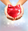 Holiday background with hands holding gift box. Concept of giving presents - PhotoDune Item for Sale