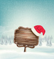 Winter christmas landscape with a wooden ornate sign and a santa hat background - PhotoDune Item for Sale