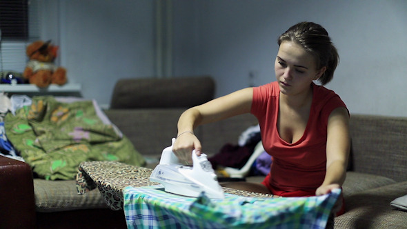 Woman Irons Clothes 2