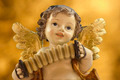 Angel with accordion on golden background - PhotoDune Item for Sale