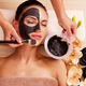 Cosmetologist smears cosmetic mask on the face of  woman - PhotoDune Item for Sale