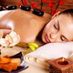 Adult woman relaxing in spa salon with hot stones on back - PhotoDune Item for Sale
