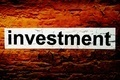 Investment text on grunge background - PhotoDune Item for Sale