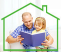smiling father and daughter reading book at home - PhotoDune Item for Sale