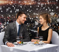 smiling couple eating main course at restaurant - PhotoDune Item for Sale