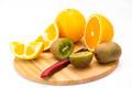 kiwi and orange on a cutting board - PhotoDune Item for Sale
