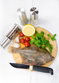 raw fish on a cutting board and knife - PhotoDune Item for Sale