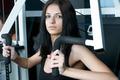 Beautiful girl in sports club on simulator - PhotoDune Item for Sale